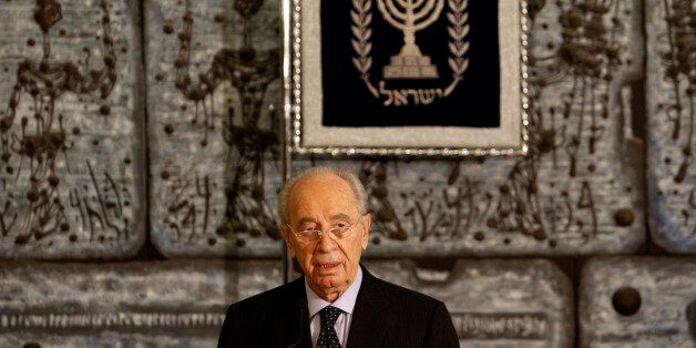 Israel's President Simon Peres delivers a statement to the press at his residence in Jerusalem September...