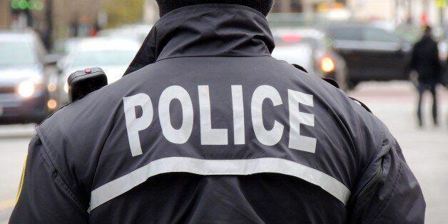 American policeman controlling the traffic in an urban area of