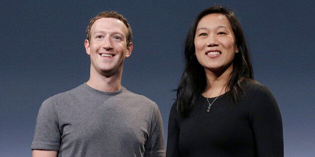 In this Tuesday, Sept. 20, 2016, photo, Facebook CEO Mark Zuckerberg and his wife, Priscilla Chan, smile...