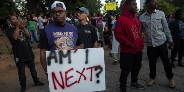 Protesters attend a demonstration against police brutality in Charlotte, North Carolina, on September...