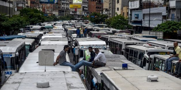 Employers of public transportation block a main avenue in Caracas during a protest due to the shortage...