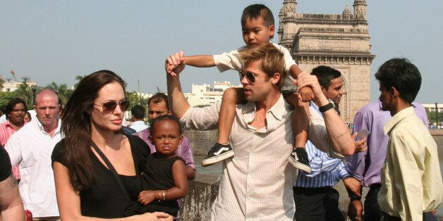 **FILE** Actress and UNHCR Ambassador Angelina Jolie, left, with daughter Zahara, and Brad Pitt, second...