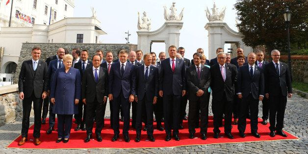 European Union leaders pose for a family photo during the European Union summit- the first one since...