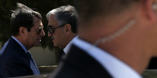 Cypriot President Nicos Anastasiades, left, and breakaway Turkish Cypriot leader Mustafa Akinci, right,...