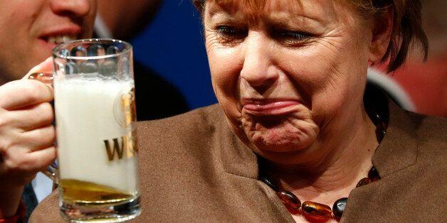 German Chancellor Angela Merkel drinks a beer during Christain Democratic Union (CDU) political Ash Wednesday...