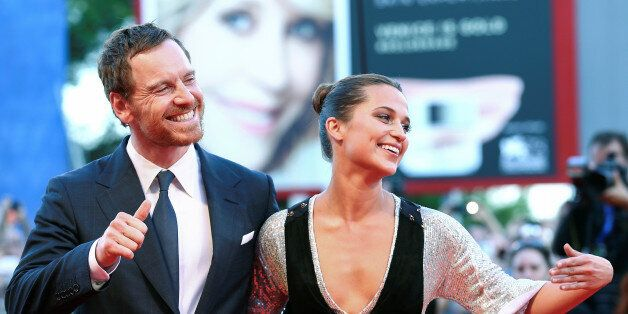 Actors Michael Fassbender and Alicia Vikander attend the red carpet event for the