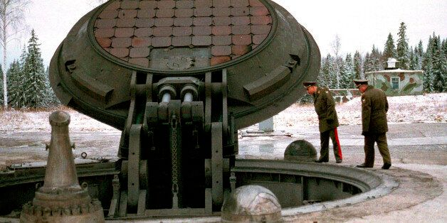 Russian military officials, no names given, look into an open silo of an intercontinental ballistic Topol-M...