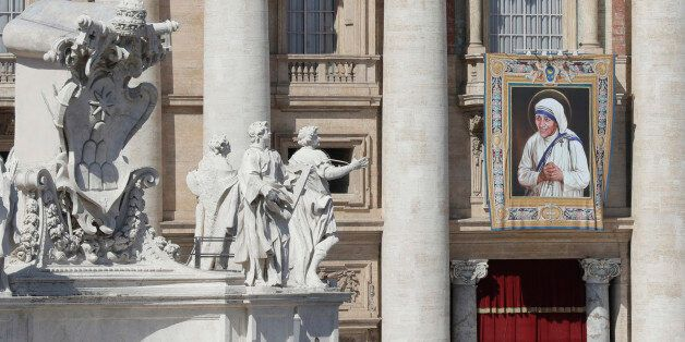 A tapestry depicting Mother Teresa hangs from the balcony of St. Peter's Basilica during her Canonization...