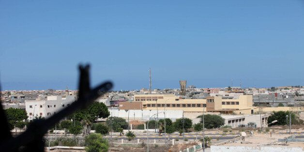 A Libyan fighter from Bonyan Marsous Brigades aims his weapon during a battle with the Islamic State...