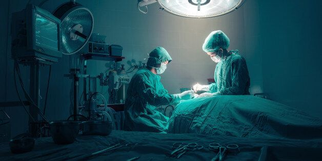 Surgeons team working with Monitoring of patient in surgical operating
