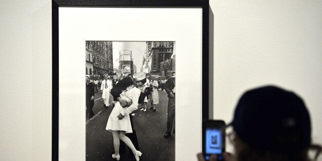 A visitor takes a snapshot of 'VJ Day a Times Square, New York, NY, 1945' by Alfred Eisenstaedt during...