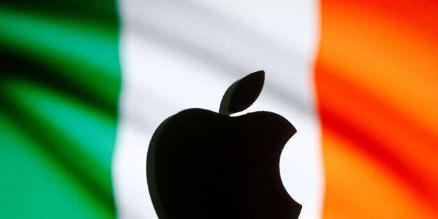 A 3D printed Apple logo is seen in front of a displayed European Union flag in this illustration taken...