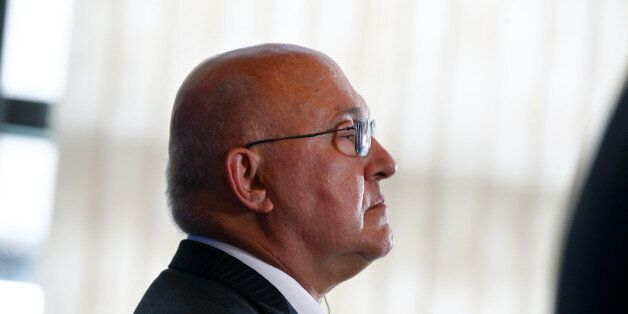 France's Finance Minister Michel Sapin gives a press conference with U.S Treasury Secretary Jacob Lew,...