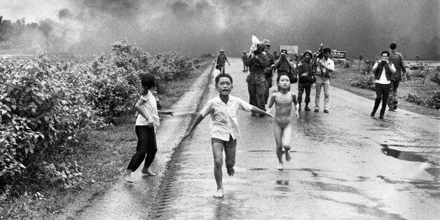 Vietnamese children flee from their homes in the South Vietnamese village of Trang Bang after South Vietnamese...