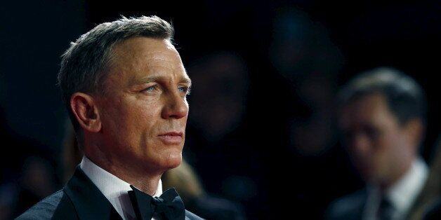 Daniel Craig poses for photographers as he attends the world premiere of the new James Bond 007 film
