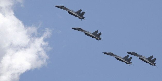 J-11B fighter jets of the Chinese Air Force fly in formation during a training session for the upcoming...