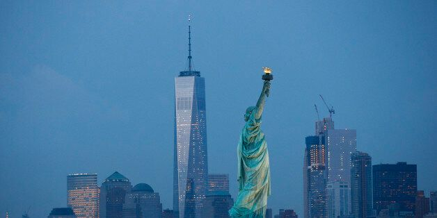NEW YORK, NY - SEPTEMBER 8: in The Statue of Liberty stands in the foreground as Lower Manhattan is viewed...