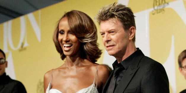 CORRECTS DATE OF DEATH TO SUNDAY, JAN. 10, 2016 - FILE - In this June 6, 2005 file photo, singer David Bowie and his wife Iman pose at the 2005 CFDA Fashion Awards in New York. Bowie, the innovative and iconic singer whose illustrious career lasted five decades, died Sunday, Jan. 10, 2016, after battling cancer for 18 months. He was 69 (AP Photo/Stuart Ramson, File)