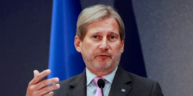 European Union's Enlargement Commissioner Johannes Hahn delivers a speech during a joint press conference...