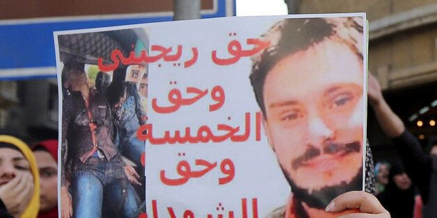 ATTENTION EDITORS - VISUAL COVERAGE OF SCENES OF INJURY OR DEATH An Egyptian activist holds a poster...