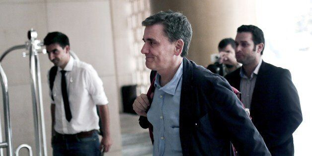 Greek Finance Minister Euclid Tsakalotos arrives for a meeting with representatives of the International...