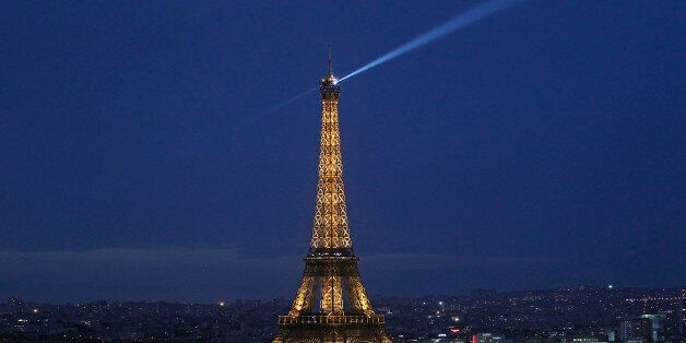 PARIS, FRANCE - DECEMBER 21: The Eiffel Tower by night is seen from the 'Arc de triomphe' on December...