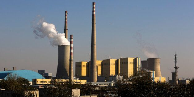 Thick white smoke billows from a coal-fired power plant in Beijing, China Thursday, Nov. 13, 2014. Chinese...
