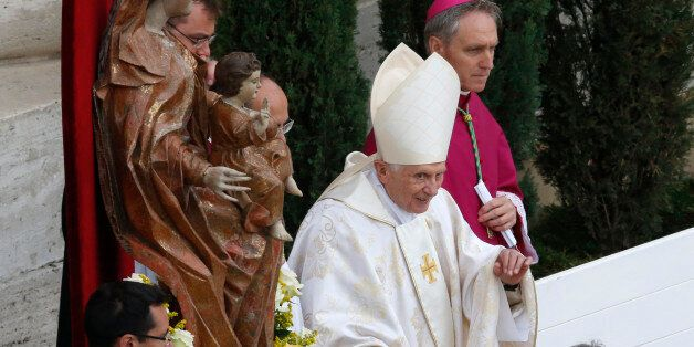 Former Pope Benedict XVI arrives to attend the canonisation ceremony of Popes John XXIII and John Paul...