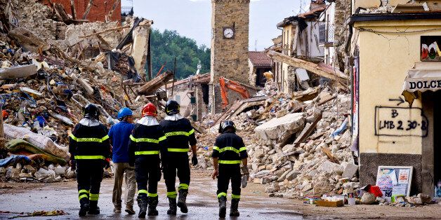 AMATRICE , ITALY AUGUST 30: Firefighters continue removing rubble near the bell tower in Amatrice,  central Italy on August 30, 2016 Italy. Italy was struck by a powerful, 6.2-magnitude earthquake in the night of August 24, 2016, which has killed at least 293 people and devastated dozens of houses in the Lazio village of Pescara del Tronto, Accumoli and Amatrice. (Photo by Stefano Montesi/Corbis via Getty Images)