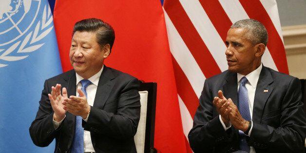 Chinese President Xi Jinping, left, and U.S. President Barack Obama applaud as U.N. Secretary-General...