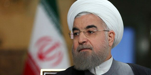 In this photo released by official website of the office of the Iranian Presidency, President Hassan...