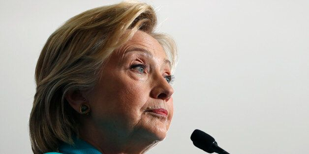 FILE - In this Aug. 25, 2016 file photo, Democratic presidential candidate Hillary Clinton pauses as...