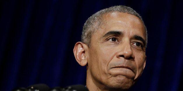 U.S. President Barack Obama pauses as he speaks during a news conference at the Landmark Mekong Riverside...