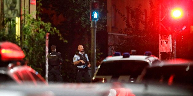 Danish police officers stand on patrol near Christiania in Copenhagen late night Wednesday, Aug. 31,...
