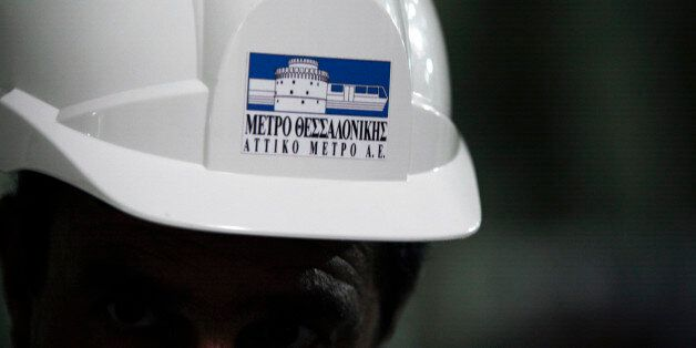 The logo of Attiko Metro SA, the state-controlled metro operator, sits on the safety helmet of a construction...