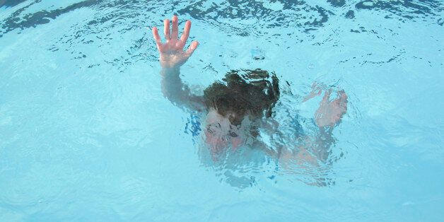 'Young boy, sinking into the water (no actual children hurt during the making of this