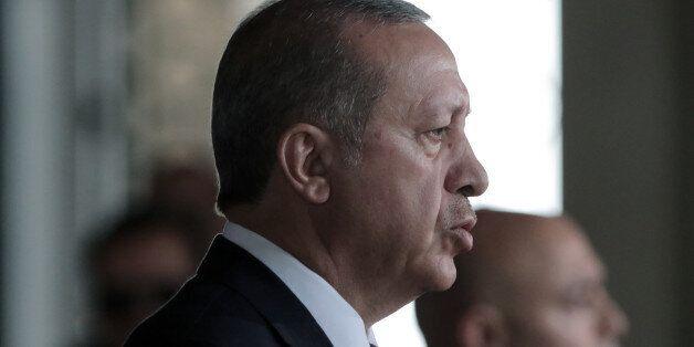 Turkish President Recep Tayyip Erdogan stands at the mausoleum of modern Turkey's founder Mustafa Kemal...