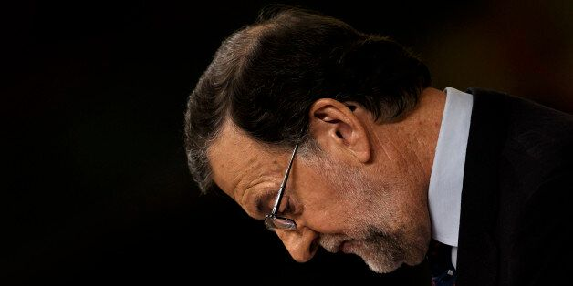 Spain's acting Prime Minister and Popular party leader Mariano Rajoy looks down as he addresses lawmakers...