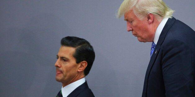 MEXICO CITY, MEXICO - AUGUST 31: President of Mexico Enrique Pena Nieto walks along US Republican presidential...