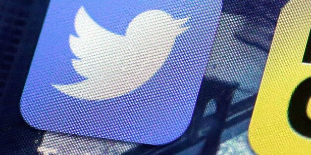 FILE - This Friday, Oct. 18, 2013, file photo, shows a Twitter app on an iPhone screen in New York. British...