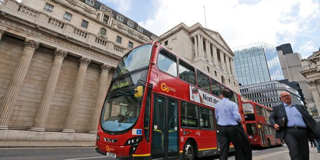 A London bus passes the Bank of England in London, Thursday, Aug. 4, 2016. The Bank of England is expected...