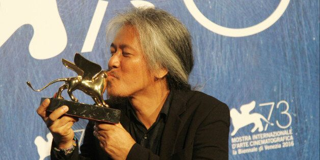 VENICE, ITALY - 2016/09/10: Director Lav Diaz with Gold Lion for the movie 'Ang Babaeng Humayo (The Woman...