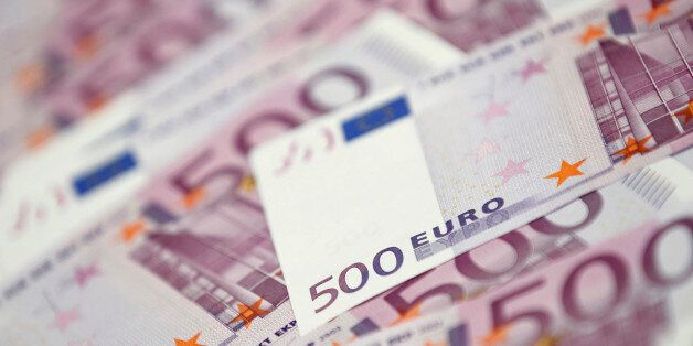 Euro notes are pictured at a bank in this photo illustration taken in Seoul June 18, 2012. South Korean...
