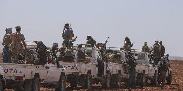 ALEPPO, SYRIA - SEPTEMBER 04 : Members of Free Syrian Army patrol at Kandura town near Jarabulus District...