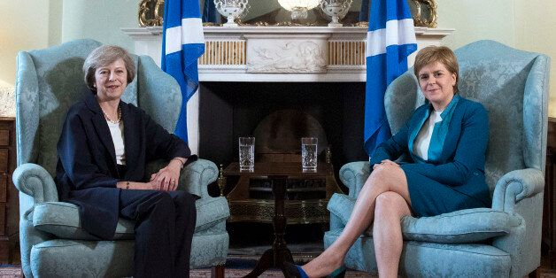Britain's new Prime Minister Theresa May, left, meets with First Minister of Scotland, Nicola Sturgeon...