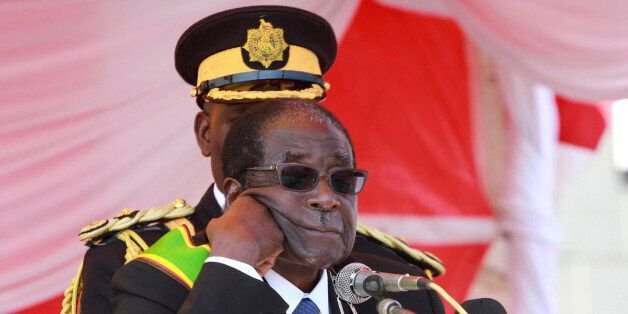 Zimbabwe's President Robert Mugabe addresses supporters at a Heroes Day rally in the capital Harare,...