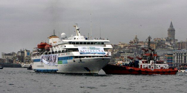 With historical Galata Tower in the background, the Mavi Marmara ship, the lead boat of a flotilla headed...