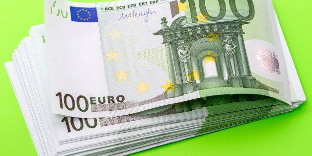Pack of bank notes hundred euros on a green