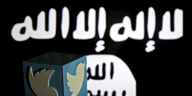 A 3D-printed Twitter logo is seen on a keyboard in front of a computer screen on which an Islamic State...