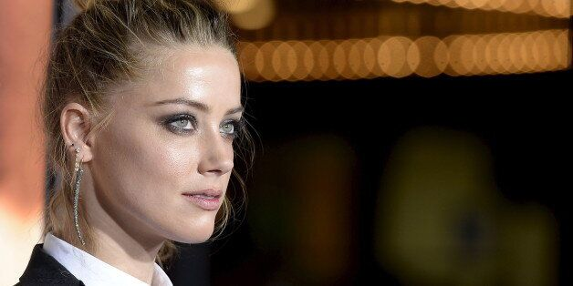 Cast member Amber Heard poses during the premiere of the film